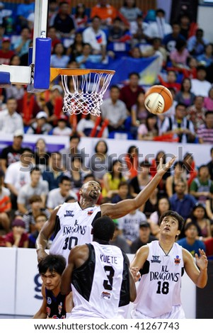 KUALA LUMPUR - NOVEMBER 15: KL Dragons' Jamal Brown goes for a rebound against the Philippine Patriots in the ASEAN Basketball League match. November 15, 2009 in Kuala Lumpur. - stock photo