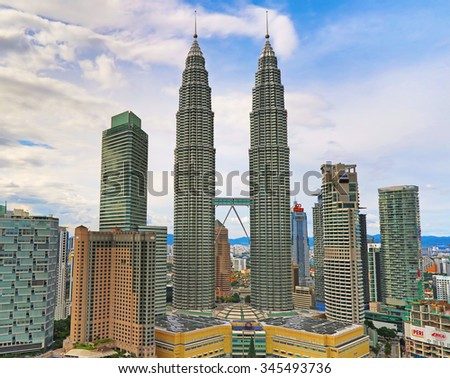 """KUALA-LUMPUR - NOVEMBER 28: """"Petronas Twin towers"""" on November 28, 2015 in Kuala Lumpur, Malaysia. """"Petronas towers"""" were tallest in the world from 1998 to 2004 and remain the tallest twin towers. - stock photo"""