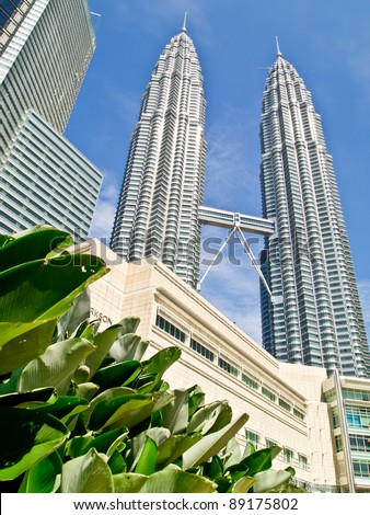 KUALA LUMPUR-NOVEMBER 17: The Petronas Twin Towers and other skyscrapers on November 17 , 2011 in Kuala Lumpur, Malaysia. The Petronas Towers are the tallest twin buildings in the world. - stock photo