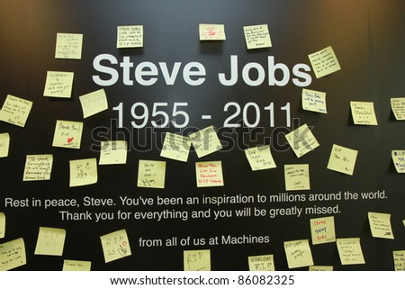 KUALA LUMPUR - OCTOBER 6: A memorial of Steve Jobs was created at Apple Store on October 6, 2011 in Kuala Lumpur, Malaysia. Apple announced the death of Steve Jobs, 56 after a long battle with cancer. - stock photo