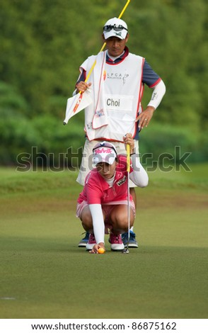 KUALA LUMPUR - OCTOBER 16: Chella Choi of South Korea prepares to putt on the final day of the Sime Darby LPGA Malaysia 2011 on October 16, 2011 at the Kuala Lumpur Golf & Country Club, Malaysia. - stock photo