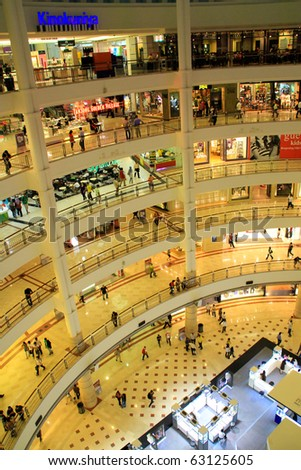 KUALA LUMPUR - OCTOBER 14: Interior of Suria KLCC on October 14, 2010 in Kuala Lumpur, Malaysia. Suria KLCC is the ultimate luxury shopping destination in Malaysia. - stock photo