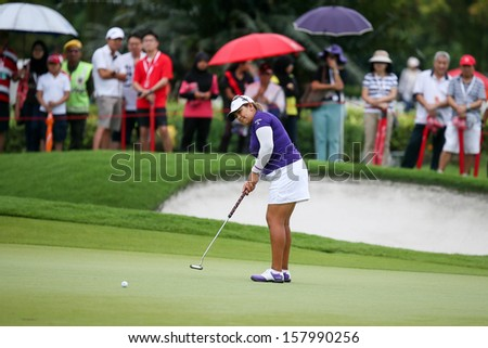KUALA LUMPUR - OCTOBER 12: Lizette Salas of USA putts at the 2nd hole green of the KLGCC course on Day 3 of the Sime Darby LPGA on October 12, 2013 in Kuala Lumpur, Malaysia. - stock photo