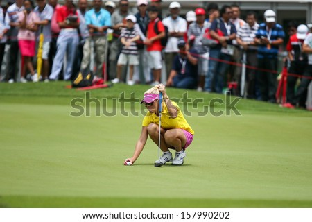 KUALA LUMPUR - OCTOBER 12: Natalie Gulbis of USA prepares for her putt at the 2nd hole green of the KLGCC course on Day 3 of the Sime Darby LPGA on October 12, 2013 in Kuala Lumpur, Malaysia. - stock photo