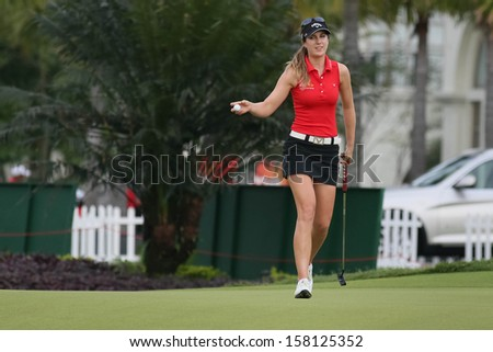 KUALA LUMPUR - OCTOBER 13: Sandra Gal of Germany reacts after a birdie putt at the 2nd hole of the KLGCC course on the final day of the Sime Darby LPGA on October 13, 2013 in Kuala Lumpur, Malaysia. - stock photo