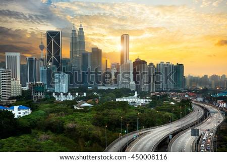 Kuala lumpur skyline in the evening, Kuala lumpur Malaysia skyline with sunset. - stock photo