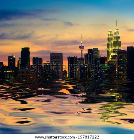 kuala lumpur skyline, the capital of malaysia view from a lake - stock photo
