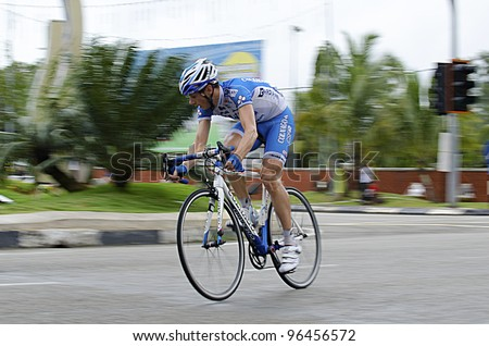 KUANTAN, MALAYSIA - MARCH 1: Canola,Marco from Colnago CSF Inox Team as leading of race in stage 7 of the Le Tour de Langkawi from Bentong to Kuantan on March 1, 2012 in Kuantan, Malaysia. - stock photo