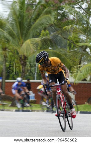 KUANTAN, MALAYSIA - MARCH 1: M. Nor Rizuan,Zainal from Malaysia National Team during race in stage 7 of the Le Tour de Langkawi from Bentong to Kuantan on March 1, 2012 in Kuantan, Malaysia. - stock photo
