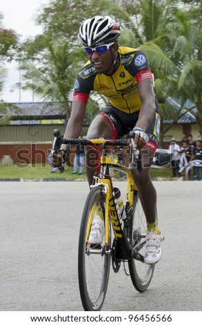 KUANTAN, MALAYSIA - MARCH 1: Russom,Meron from MTN Qhubeka team during race in stage 7 of the Le Tour de Langkawi from Bentong to Kuantan on March 1, 2012 in Kuantan, Malaysia. - stock photo