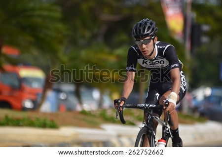 KUANTAN - MARCH 12: unidentified cyclists in action during stage five of the 2015 Le Tour de Langkawi (LTdL) on March 12, 2015 in Kuantan, Pahang, Malaysia. - stock photo