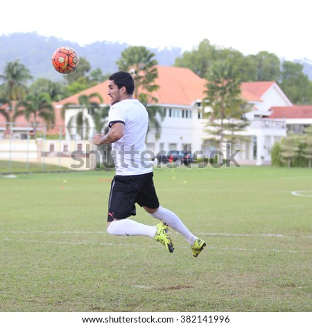 Kuantan, Pahang - JAN 28: Pahang midfielder, Pacheco heads the ball during the training Pahang FC Team at Taman Gelora field - stock photo