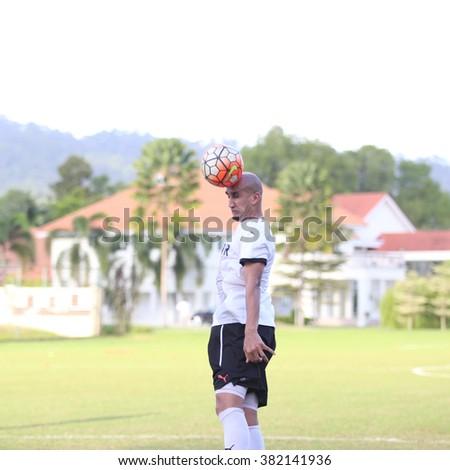 Kuantan, Pahang - JAN 28: Zesh Rehman heads the ball during the training Pahang FC Team at Taman Gelora field - stock photo
