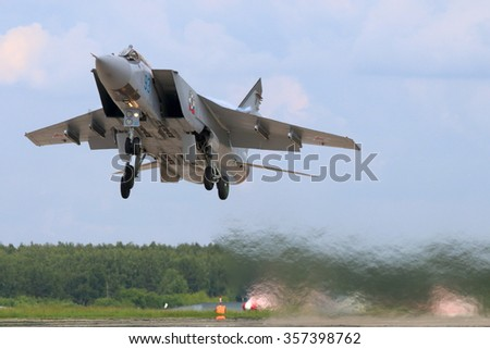KUBINKA, MOSCOW REGION, RUSSIA - JUNE 22, 2015: Mikoyan Gurevich MiG-31BM RF-92379 jet fighter takes off at Kubinka air force base,