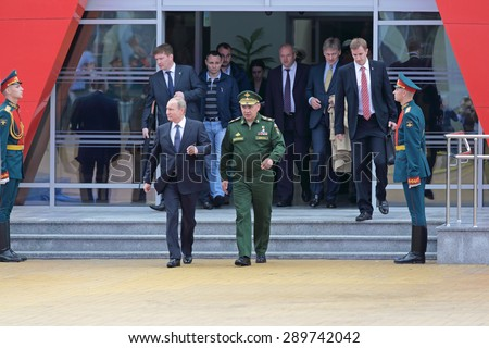 KUBINKA, RUSSIA - JUN 16, 2015: The President of Russia Vladimir Putin and Minister of Defense Sergey Shoygu at the International military-technical forum ARMY-2015 in military-Patriotic park - stock photo