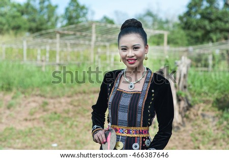Kudat, Sabah Malaysia. April 10, 2016: A girl from Rungus ethnic wearing traditional costume poses for the camera during the local Festival celeberation in Kudat, Sabah.