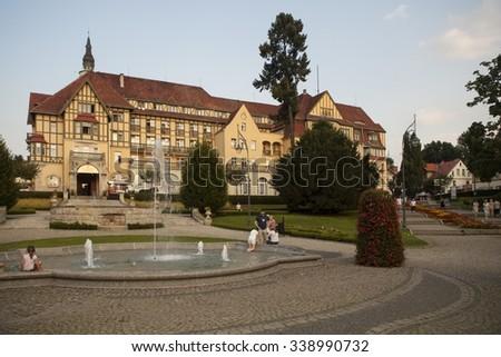 KUDOWA ZDROJ, POLAND - MAY 25, 2014:Kudowa is a town located below Stolowe Mountains in Klodzko County, Lower Silesian Voivodeship. It is located right at the Polish-Czech border. - stock photo