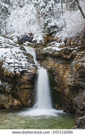 Kuhfluchtfaelle waterfall with snow-covered rocks in winter, Farchant, Garmisch-Partenkirchen, Bavaria, Germany