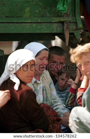 KUKES, ALBANIA, 04 MAY 1999 --- Kosovar Albanians at a refugee camp in northern Albania. The Kosovar Albanians were ethnically cleansed from their homes in Kosovo by Serbian security forces.