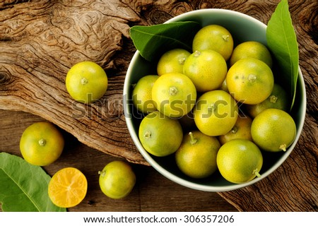 kumquat citrus fruits in bowl - stock photo
