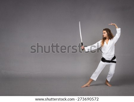 kung fu with katana on hand, textured background