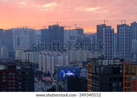 KUNMING, CHINA - NOVEMBER 25: New Construction on the outskirts of China's major cities, November 25, 2015, Kunming, China. China's economic boom leaves a trail of ghost cities. - stock photo