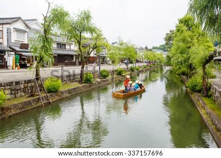 Kurashiki river in Kurashiki city. The preservative city of Okayama prefecture. Japan. Beautiful japanese old town with typical architecture. - stock photo