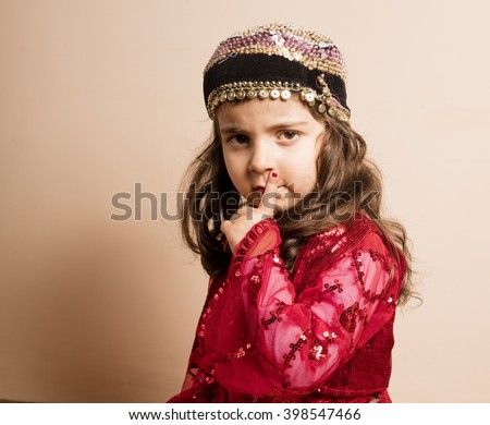 Kurdish girl in red classic kurdish dress in Iraq - stock photo