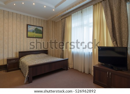Kursk city, Russia - Apr. 4, 2016 in hotel room: the interior is beautiful and spacious bedroom done in bright colors and with colorful color Wallpaper
