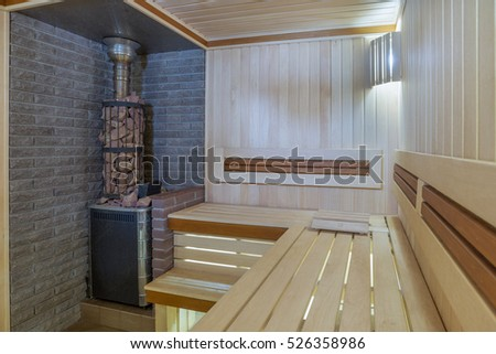 Kursk city, Russia. Jan. 17, 2016 in sauna: Russian wooden sauna with a stone oven, and a spacious steam room. In the sauna with exclusive materials, oak switches and lighting, cariitti