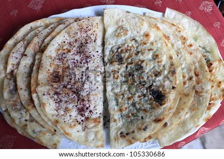 Kutabi with greens and meat in azerbaijani restaurant - stock photo