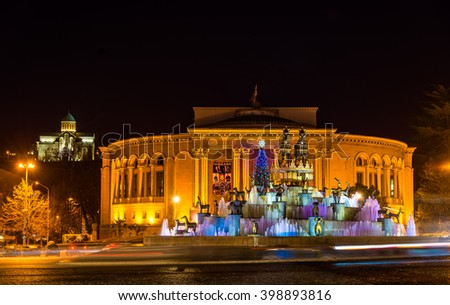 Kutaisi, Georgia - January 11, 2016: Kolkhida Fountain, Georgian Drama Theatre and Bagrati Cathedral in the evening