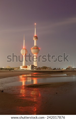 KUWAIT - DEC 7: Arabian Gulf beach and the Kuwait Towers. The Towers were build in 1979 and are a symbol of modern Kuwait. December 7, 2014 in Kuwait City  - stock photo