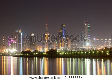 KUWAIT - DEC 8: Skyline of Kuwait City illuminated at night. December 8, 2014 in Kuwait, Middle East - stock photo