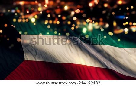 Kuwait National Flag Light Night Bokeh Abstract Background - stock photo