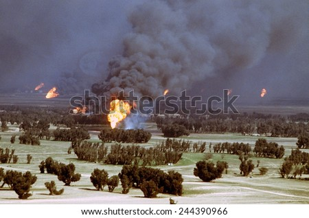 Kuwaiti oil wells were set on fire by retreating Iraqi forces during Operation Desert Storm. Mar. 2 1991 - stock photo