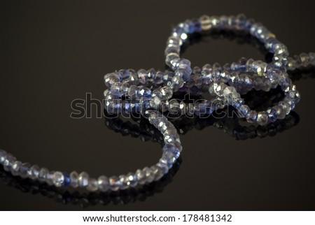 kyanite necklace on black  - stock photo