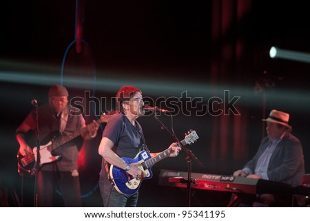 "KYIV - FEBRUARY 14: Chris Rea performs as part of the tour ""Santo Spirito Blues"", on stage at ""Ukraine"" Palace on February 14, 2012 in Kyiv, Ukraine."