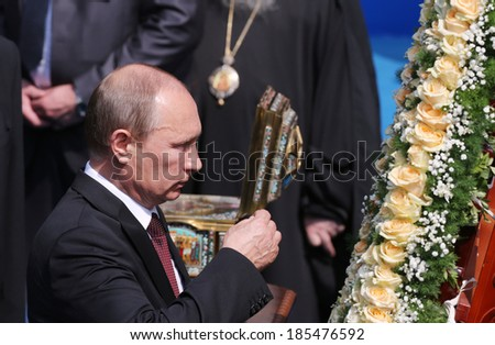 KYIV - JUL 27: President of Russia Vladimir Putin attend a ceremony marking the 1,025th anniversary of the Christianization of Kievan Rus in Kiev, Ukraine. July 27, 2013. - stock photo