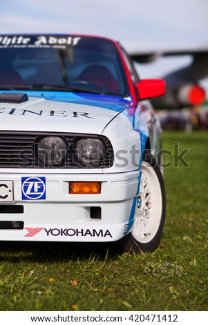 KYIV, UKRAINE - April 22, 2016: Car BMW e30 M3 at festival of vintage cars OldCarLand-2016 in Kiev. Side view, in front. - stock photo