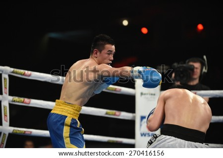 Kyiv, UKRAINE - April 17, 2015 :  DUSMATOV Hasanboy (UA) in the ring during boxing fight Ukraine Otamans vs China Dragons in Palace of Sport in Kiev, Ukraine