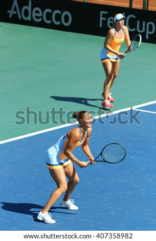 KYIV, UKRAINE - APRIL 17, 2016: Kateryna Bondarenko and Olga Savchuk of Ukraine in action during BNP Paribas FedCup World Group II Play-off pair game against Argentina at Campa Bucha Tennis Club