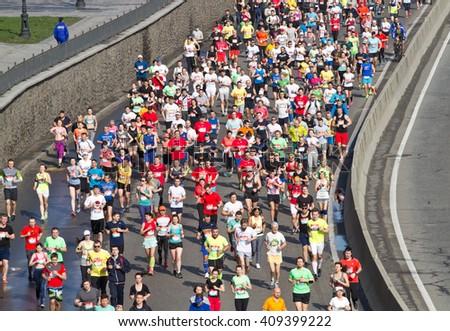 KYIV, UKRAINE - APRIL 17, 2016:Kiev half marathon in Kyiv, Ukraine. The number of runners were more than eight thousand people. - stock photo