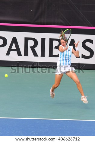 KYIV, UKRAINE - APRIL 16, 2016: Nadia Podoroska of Argentina in action during BNP Paribas FedCup World Group II Play-off game against Lesia Tsurenko of Ukraine at Campa Bucha Tennis Club in Kyiv