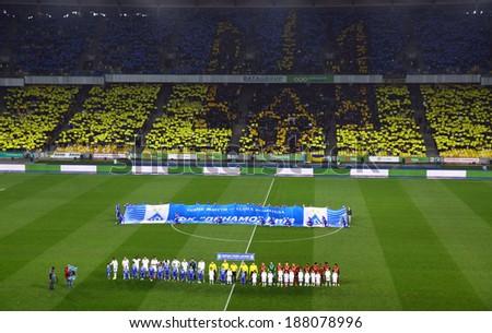 KYIV, UKRAINE - APRIL 16, 2014: Performance of Ukrainian patriotic football fans before Ukraine Championship game between FC Dynamo Kyiv and FC Shakhtar Donetsk at NSC Olimpiyskiy stadium in Kyiv - stock photo