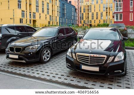 Kyiv, Ukraine - April 16th, 2016: BMW X1 vs Mercedes-Benz E-Class  - stock photo