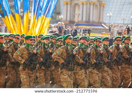 KYIV, UKRAINE - AUGUST 24: Border guard troopers of the Ukrainian Army at the military parade on August 24, 2014 in Kyiv, Ukraine. These guys take a part in the anti-terrorists operation in Donbass. - stock photo