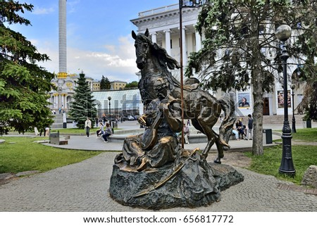 KYIV, UKRAINE - CIRCA  MAY, 2017: Celebration 1535-th Day of Kyiv. Peoples rest in square near bronze monument for Cossack Mamay with horse and bandura