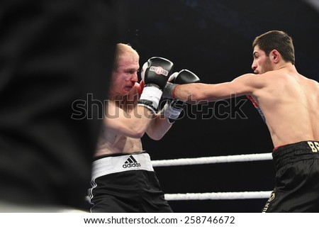 Kyiv, UKRAINE - December 13, 2014 : An unidentified boxers in the ring during fight for ranking points in the Palace of sport, Kiev, Ukraine