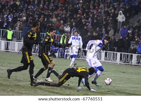 KYIV, UKRAINE - DECEMBER 15: Andriy Yarmolenko of Dynamo Kyiv (R) fights for a ball with Sheriff Tiraspol players during their UEFA Europa League game on December 15, 2010 in Kyiv, Ukraine